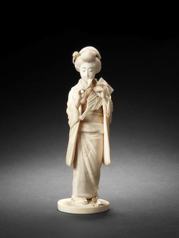 An ivory figure of a bijin By Kazutomi, Meiji Period