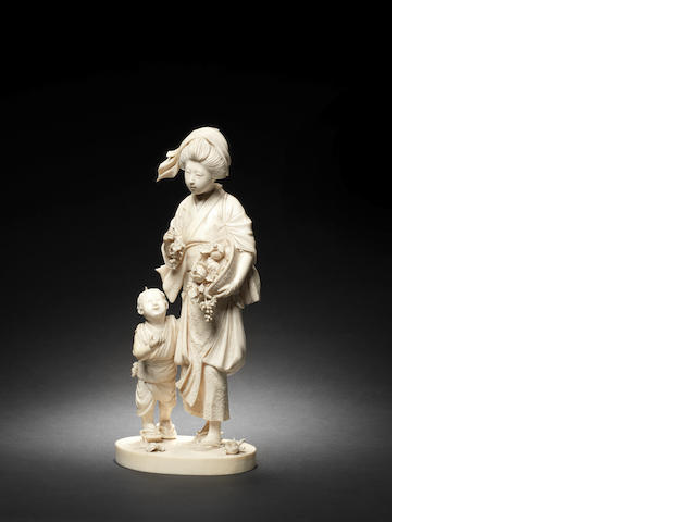 An ivory okimono group of a bijin and child By Yoshiaki/Ryomei, Meiji Period