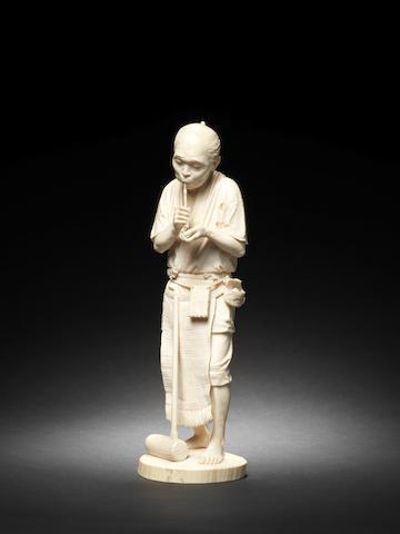 A Tokyo School ivory figure of an artisan Meiji Period