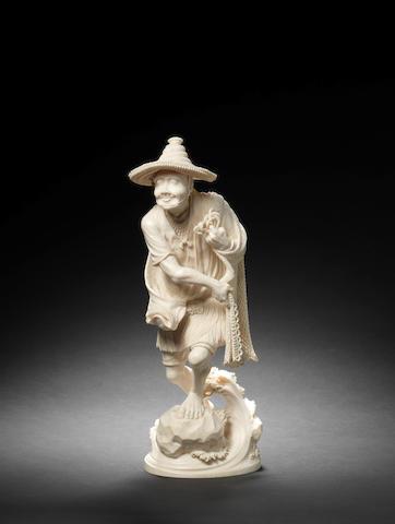 A Tokyo School ivory figure of a fisherman By Shoko/Masahiro, Meiji Period