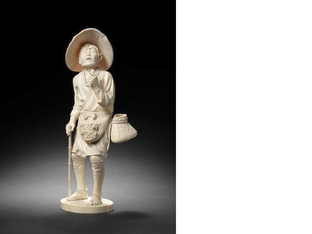 A Tokyo School ivory figure of a bird-catcher Meiji Period