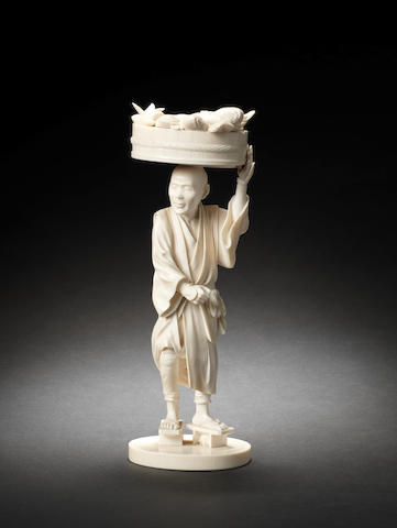 An ivory figure of a fishmonger By Sogyo/Muneyuki, Meiji Period