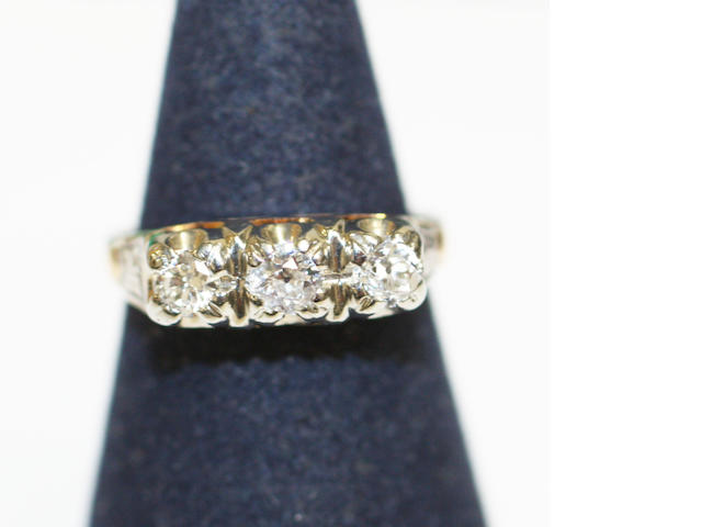 A diamond three stone ring,