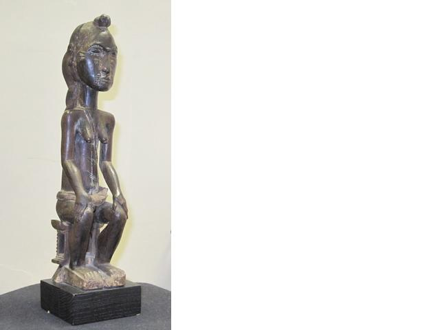 A Baule female figure, Ivory Coast