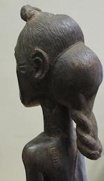 A Baule figure of a spirit wife, blolo bla, Ivory Coast, 36cm high