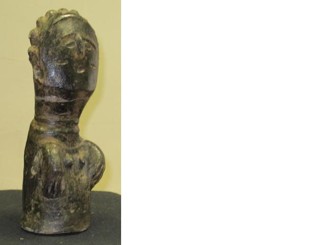 An Akan Agni terracotta female torso, Ghana