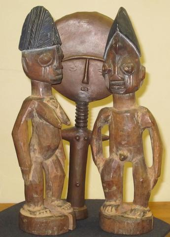 A pair of Yoruba ibejis and a brass casting of an Ashanti doll, Nigeria (3)