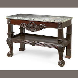 A mahogany two-tier pier table in the George III style