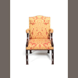A mahogany framed Gainsborough type upholstered open arm chair