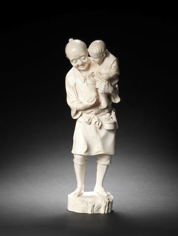 A Tokyo School ivory group of an old man and child Meiji Period