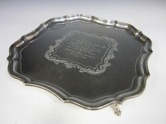 A silver shaped square salver by Barker Brothers Silver Ltd., Birmingham 1948