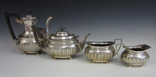 An Edwardian silver composite four tea and coffee service by Walker and Hall,  Sheffield 1905/6, Chester 1906,   (4)