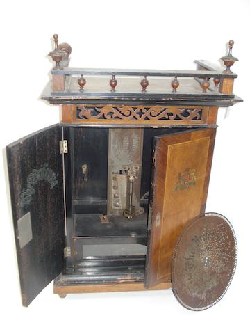 An 11.3/4-inch Britannia coin-operated upright disc musical box,
