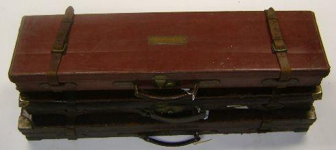 A Thomas Horsley & Son brass-mounted oak and leather single-guncase (3)