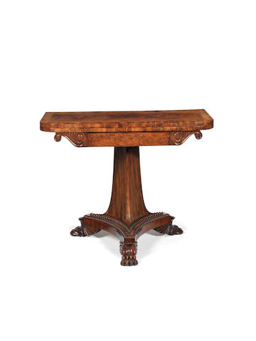 A Regency carved mahogany and crossbanded card table