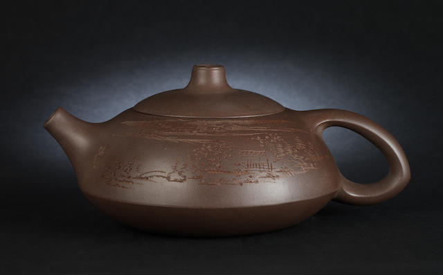 A compressed Yixing teapot and cover