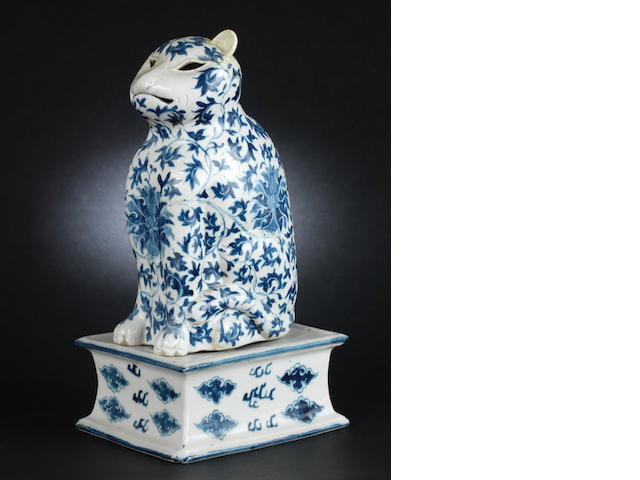 A blue and white sectional night light, designed as a seated cat