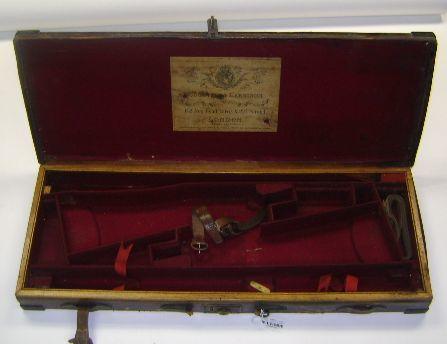 A Cogswell & Harrison brass-mounted oak and leather double-guncase