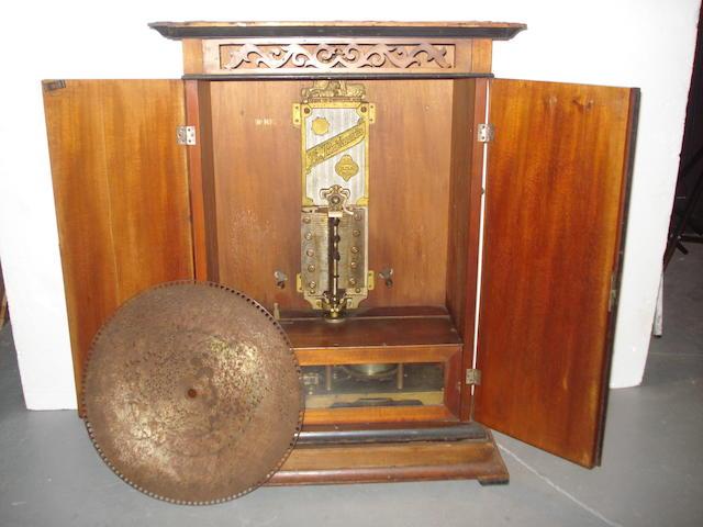 A 17.1/4-inch upright Britannia disc musical box,