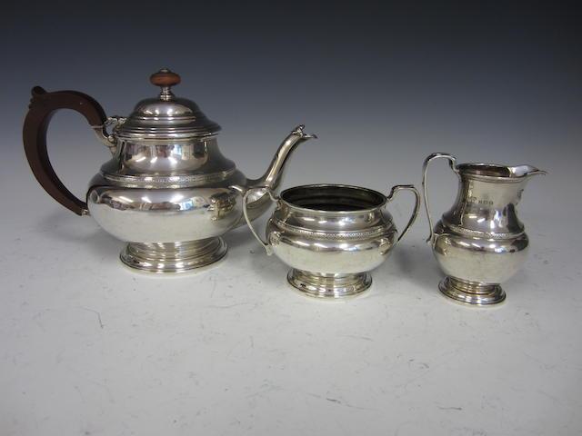 A silver circular three piece tea service Birmingham 1932  (3)