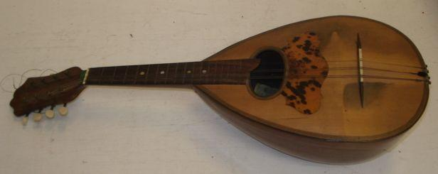 An Italian rosewood and banded mandolin, labelled Francesco Perretti & Figli, Napoli, in carrying case.