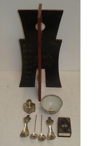 A Chinese silver pepperete, of quatre lobed outline, a pair of Chinese silver spoons, a pair of Malayan spoons, a Chinese 'famille rose' tea bowl, Qianlong, a Chinese painted and decorated model procession, in wooden box, a carved and lacquered wig stand, a painted glass hanging lantern and a cloisonne match box sleeve.