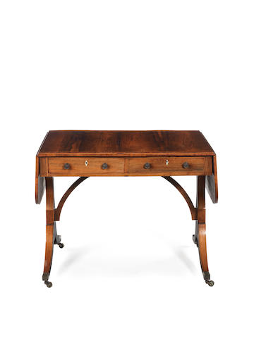A Regency rosewood and tulipwood banded sofa table
