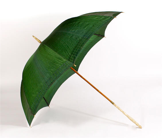 A 19th century parasol with Chinese carved ivory handle