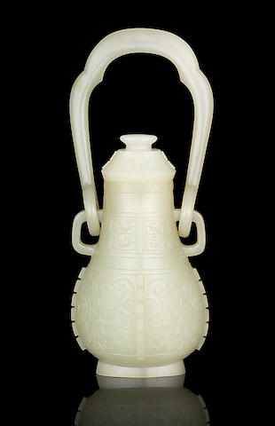 A rare Imperial very pale green jade archaistic hanging vase and cover, you Qianlong