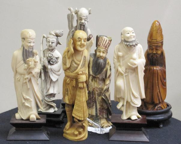 Seven 20th Century Oriental ivory carvings