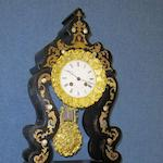 A late 19th Century French ebonised mantel clock,