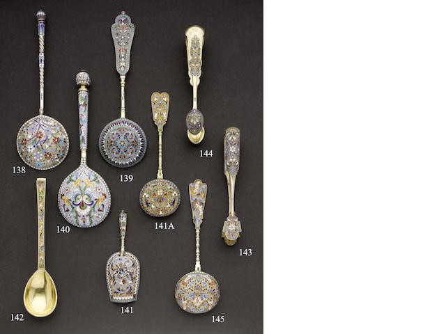 A late 19th century Russian silver-gilt and enamelled serving spoon maker's mark distorted, Moscow
