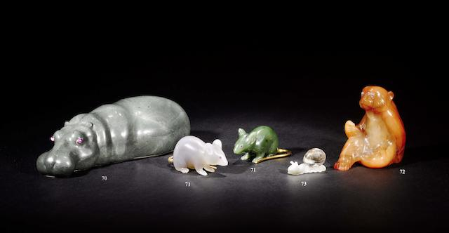A grey hardstone and gem set modelled of a couchant hippopotamus, the mounts with pseudo Russian marks