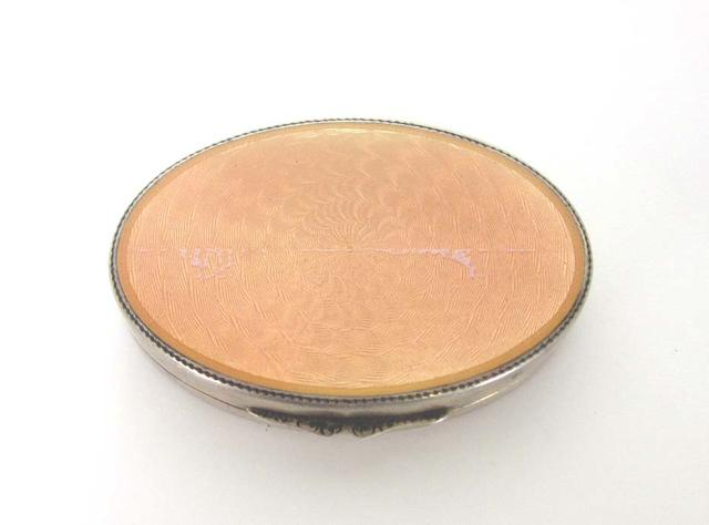 An enamelled silver oval minaudière stamped 935 and with French control marks