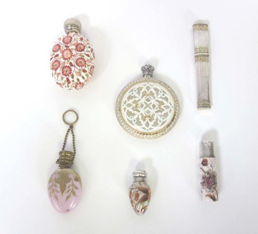 A Grainger reticulated silver capped scent bottle late 19th century and five further scent bottles (6)