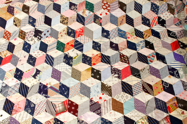 A large 'tumbling blocks' quilt, early 20th century