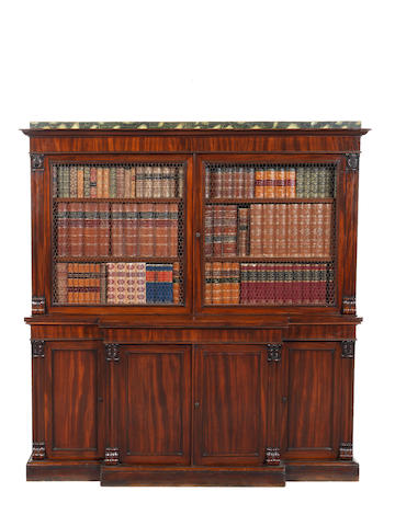 A small Regency carved mahogany breakfront bookcase in the manner of T & G Seddon