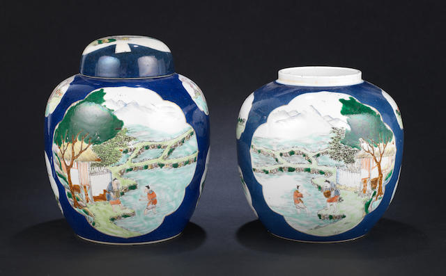 An associated pair of powder-blue ground, famille verte vases Qind Dynasty or later