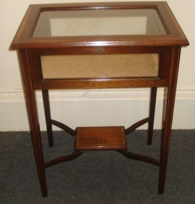 A reproduction Edwardian style mahogany satinwood crossbanded boxwood and ebony strung bijouterie table, with hinged glazed inset top and sides, on square tapered legs, 58cm.