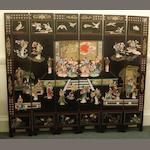 A 20th Century Chinese lacquered six fold screen, with relief carved polychrome panels of birds, figures and foliage, 183 x 104cm.
