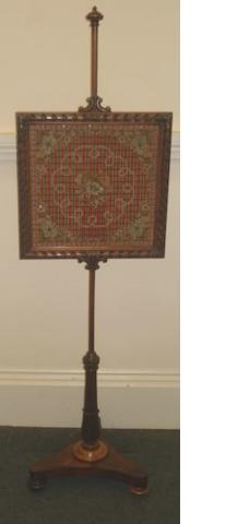 An early Victorian rosewood polescreen, the square glazed adjustable frame with beaded and woolwork panel on pole stand with triform base, 162cm high.