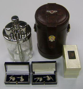 A cased flask set (3)