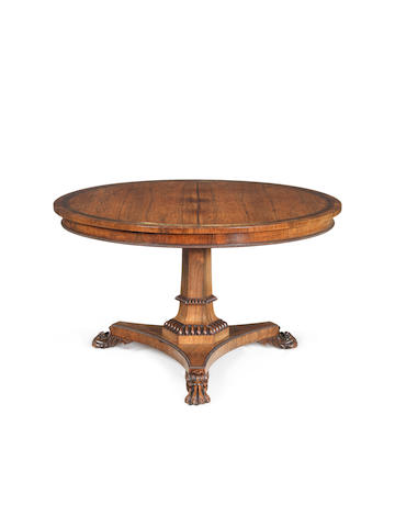 A Regency rosewood, crossbanded and brass marquetry breakfast table in the manner of Gillows
