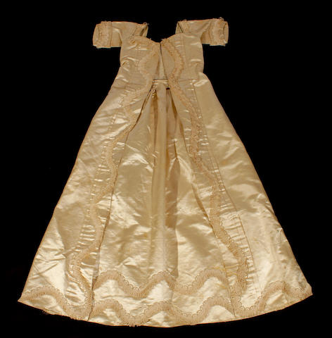 A late 18th century christening gown, further christening gowns and caps