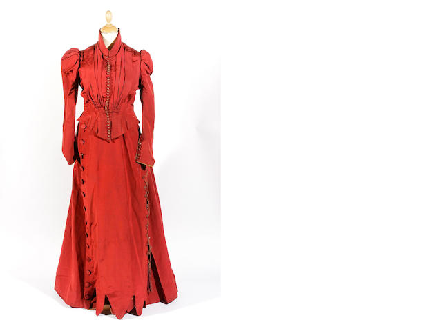 A 1880s red silk dress and mother and daughter's duster coats