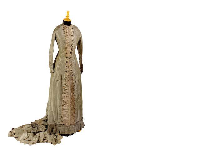 A late 1870s grey silk day dress