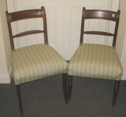 A set of eight early 19th Century rope back dining chairs, with fielded top rails and moulded frames on turned front legs, repairs.
