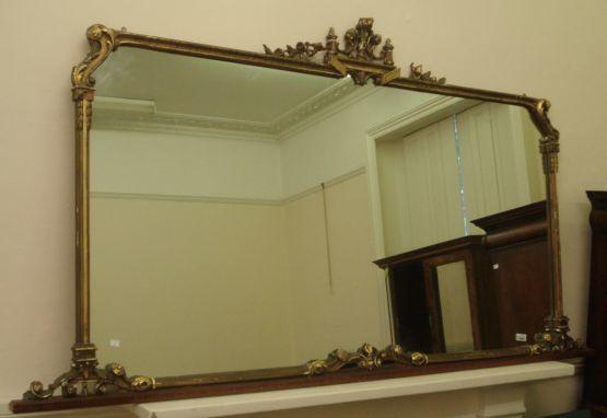 A 20th Century overmantle mirror, the rectangular plate in moulded gilt and walnut frame, 27.7 long, x 119cm high.