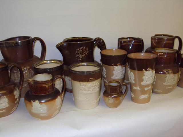 A collection of Royal Doulton hunting jugs and beakers