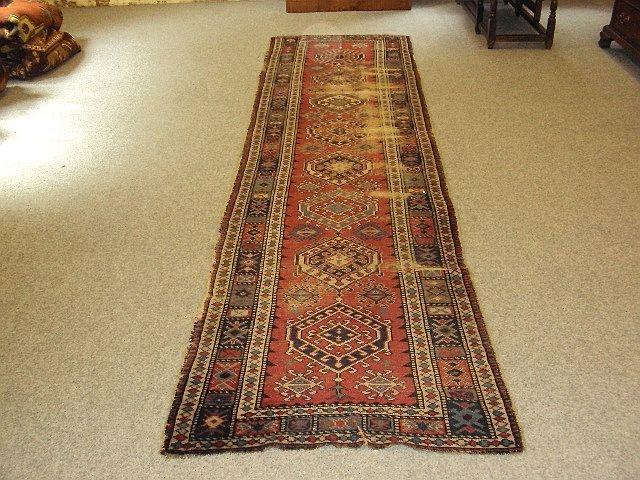 A North West Persian runner 357cm x 94cm
